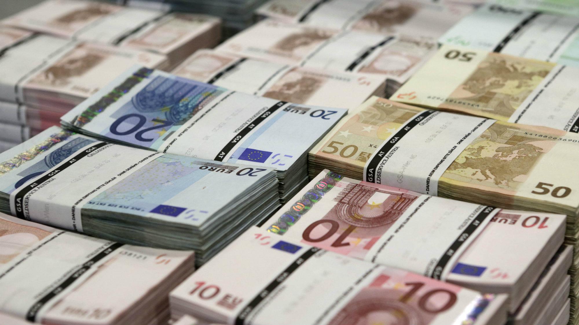 Piles of Euro banknotes