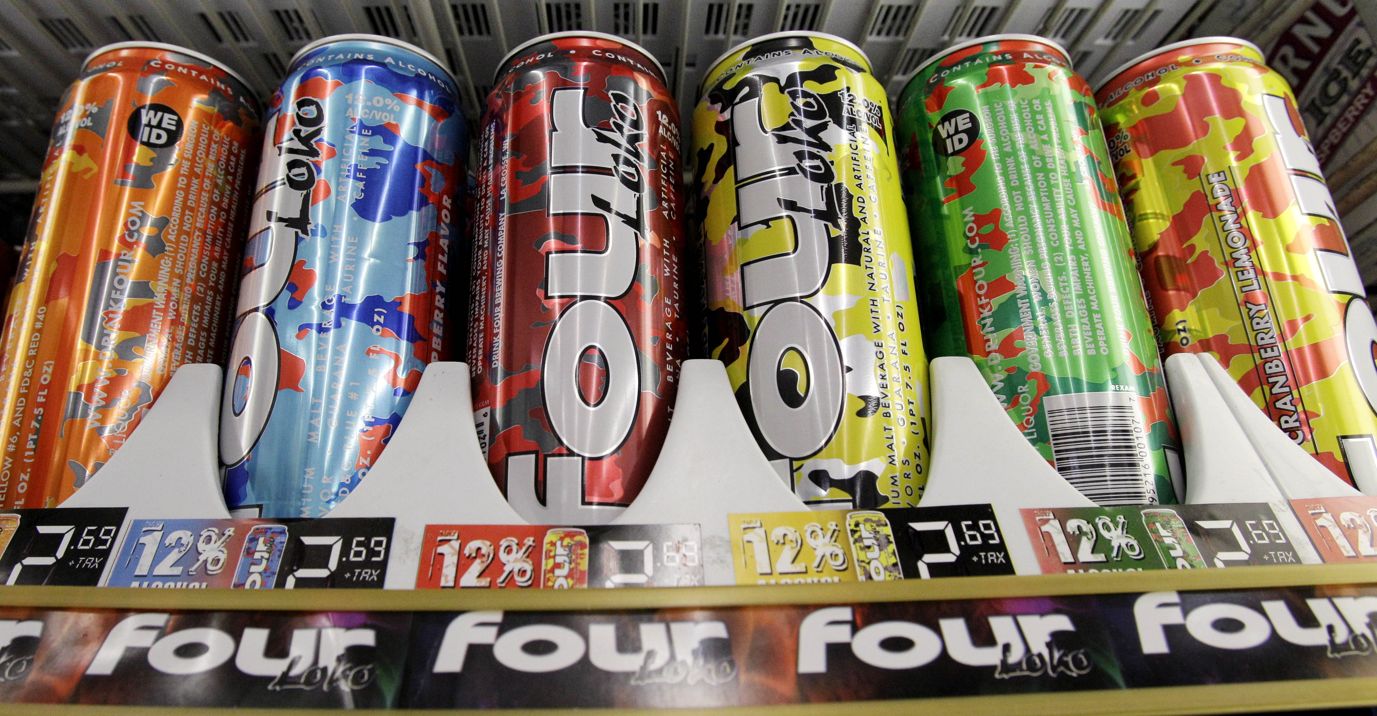 In this Nov. 10, 2010 file photo, Four Loko alcoholic energy drinks are seen in the cooler of a convenience store, in Seattle. The Food and Drug Administration is expected to announce a virtual ban of alcoholic energy drinks Wednesday, Nov. 17, 2010, even as a leading manufacturer is pulling its products off the market.