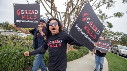 AIDS advocates participate in a rolling protest caravan in Rancho Palos Verdes, CA, Wednesday June 8, 2016, targeting Gilead Sciences over its drug pricing and policies during the drug giant's presentation at Goldman Sachs' Annual Healthcare Conference at the exclusive Terranea Resort. The protest followed a recent and blistering Los Angeles Times article that revealed Gilead's blatant patent manipulation in order to maximize profits on its drugs containing tenofovir, a key HIV/AIDS drug. The protest included a hearse, a double-deck bus and 30-40 individual cars featuring placards and banners reading 'Gilead Greed Kills.'