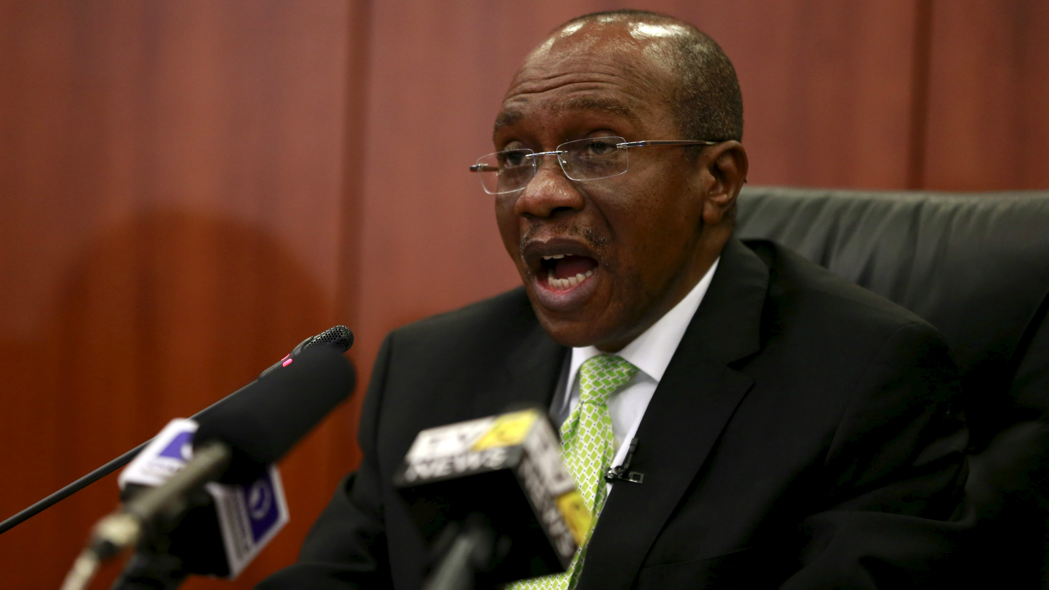 Governor Godwin Emefiele announces that Nigeria's central bank is keeping its benchmark interest rate on hold at 13 percent in Abuja, Nigeria, July 24, 2015. Nigeria's central bank kept its benchmark interest rate on hold at 13 percent on Friday, saying concerns about rising inflation and expected normalisation of U.S. interest rates meant monetary policy in Africa's biggest economy had to remain tight