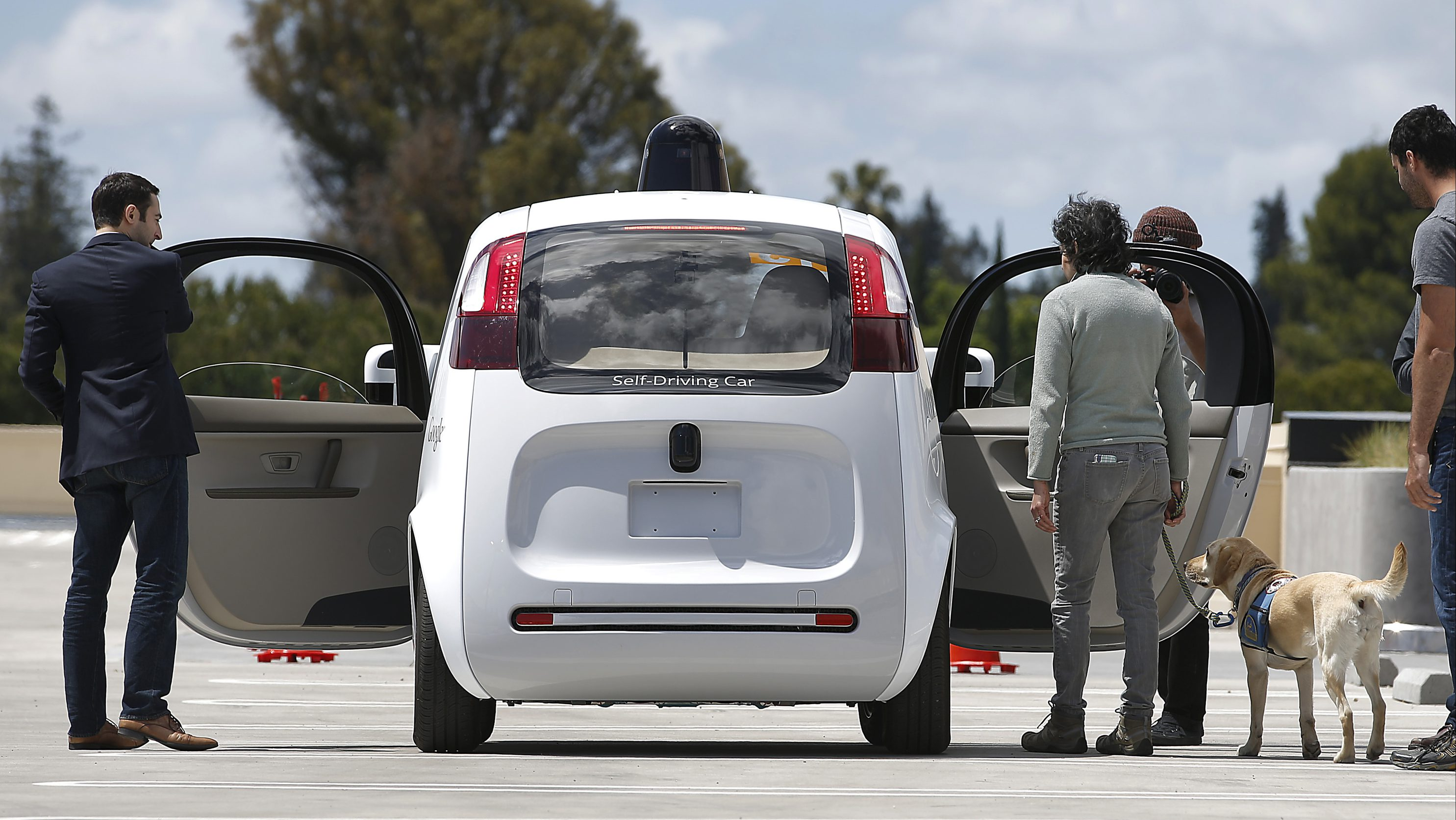 FILE - This May 13, 2015 file photo shows the front of Google's new self-driving prototype car during a demonstration at the Google campus in Mountain View, Calif. New cars that can steer and brake themselves may lull drivers into a false sense of security. One way to keep people alert may be providing distractions that are now illegal, just one surprising finding from Stanford University research that studied the behavior of students in a self-driving car simulator.(AP Photo/Tony Avelar, File)