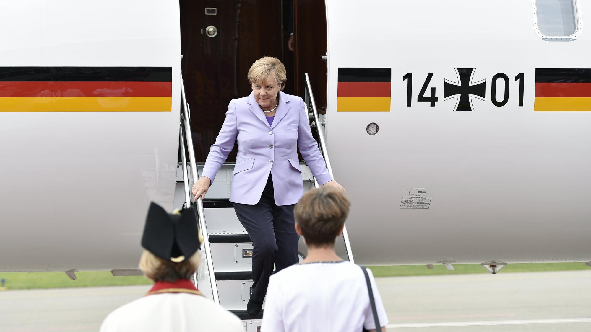 German Chancellor Angela Merkel disembarks a plane.