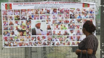 Residents read a Nigerian army poster of wanted Boko Haram suspects in Bayelsa, Nigeria