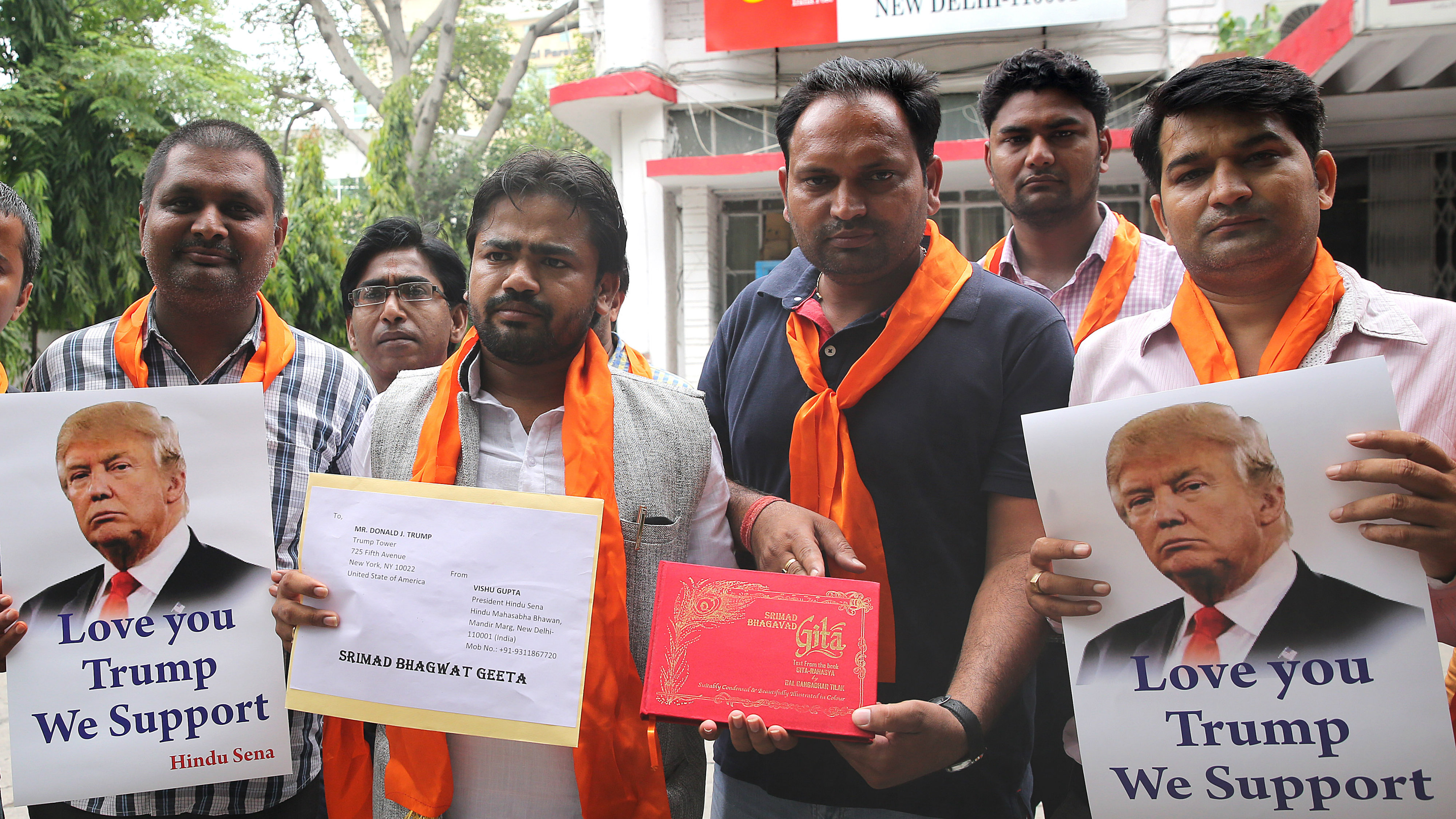 Indian activists from the right-wing organization Hindu Sena hold a Hindu holy book before sending it to US Republican Presidential nominee Donald Trump.