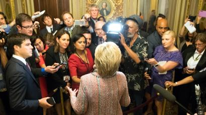 Democratic presidential candidate Hillary Clinton speaks to reporters after meeting with Senate Democrats on Capitol Hill in Washington, Thursday, July 14, 2016.