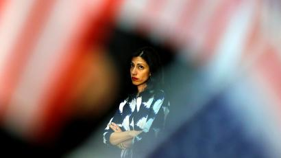 Long time aid to U.S. Democratic presidential candidate Hillary Clinton, Huma Abedin, waits in the wings as Clinton makes a campaign stop in Fresno, California, United States June 4, 2016.