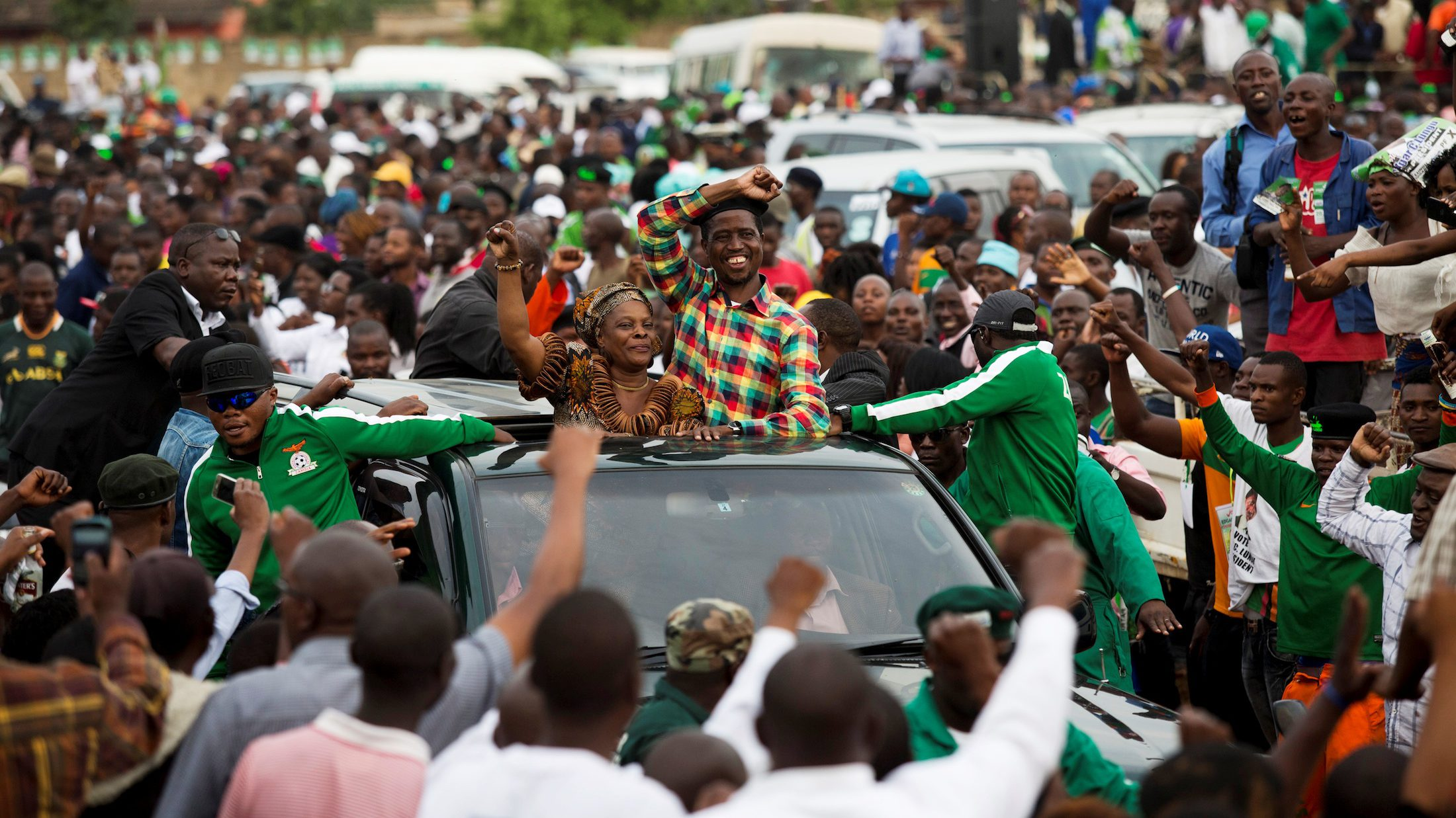 Zambia's incumbent president Edgar Lungu and his wife Esther leave a rally.