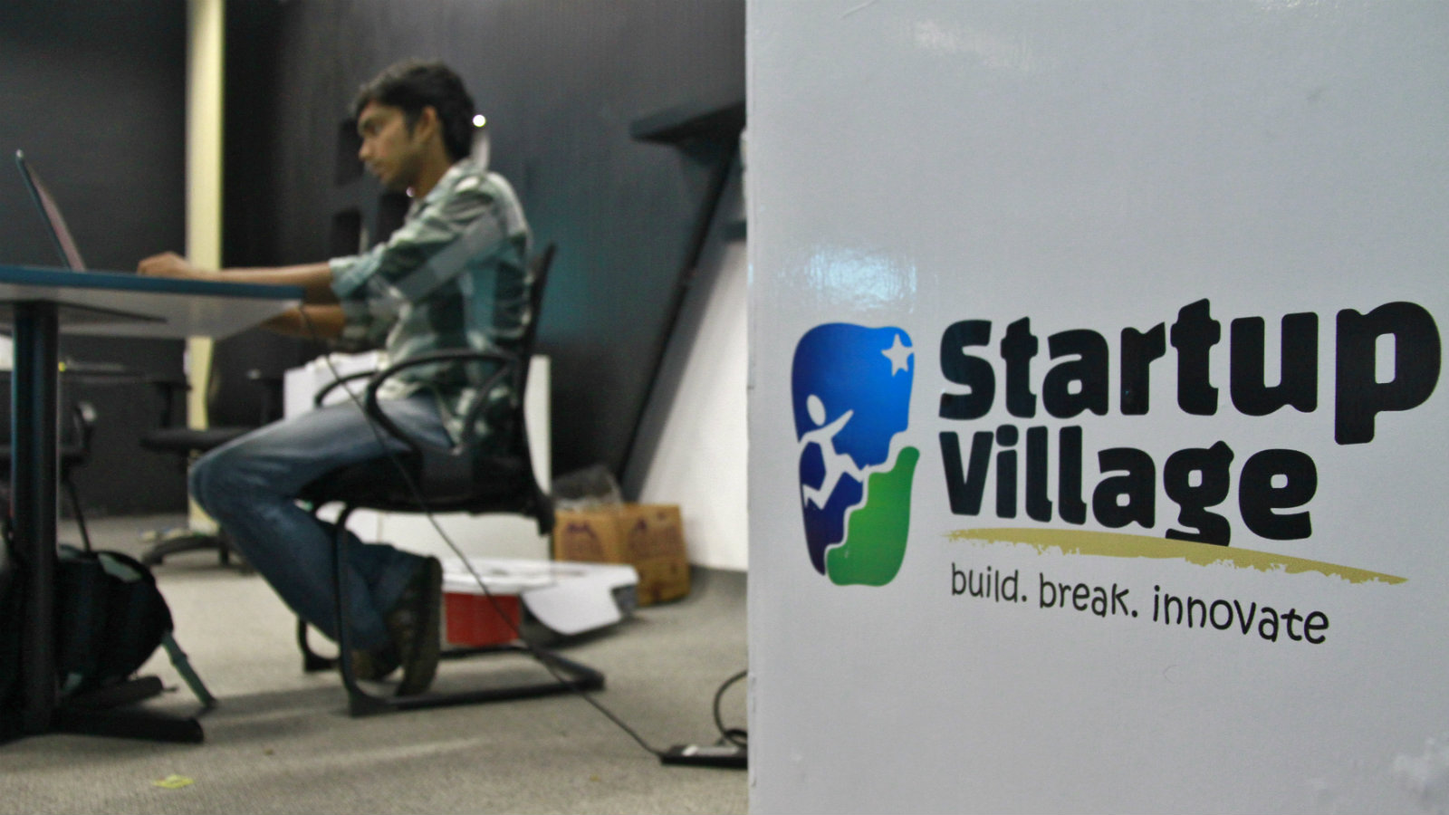An employee works on his laptop at the Start-up Village in Kinfra High Tech Park in the southern Indian city of Kochi October 13, 2012. Three decades after Infosys, India's second-largest software service provider, was founded by middle-class engineers, the country has failed to create an enabling environment for first-generation entrepreneurs. Startup Village wants to break the logjam by helping engineers develop 1,000 Internet and mobile companies in the next 10 years. It provides its members with office space, guidance and a chance to hobnob with the stars of the tech industry. But critics say this may not even be the beginning of a game-changer unless India deals with a host of other impediments - from red tape to a lack of innovation and a dearth of investors - that are blocking entrepreneurship in Asia's third-largest economy. To match Feature INDIA-TECHVILLAGE/ Picture taken October 13, 2012.