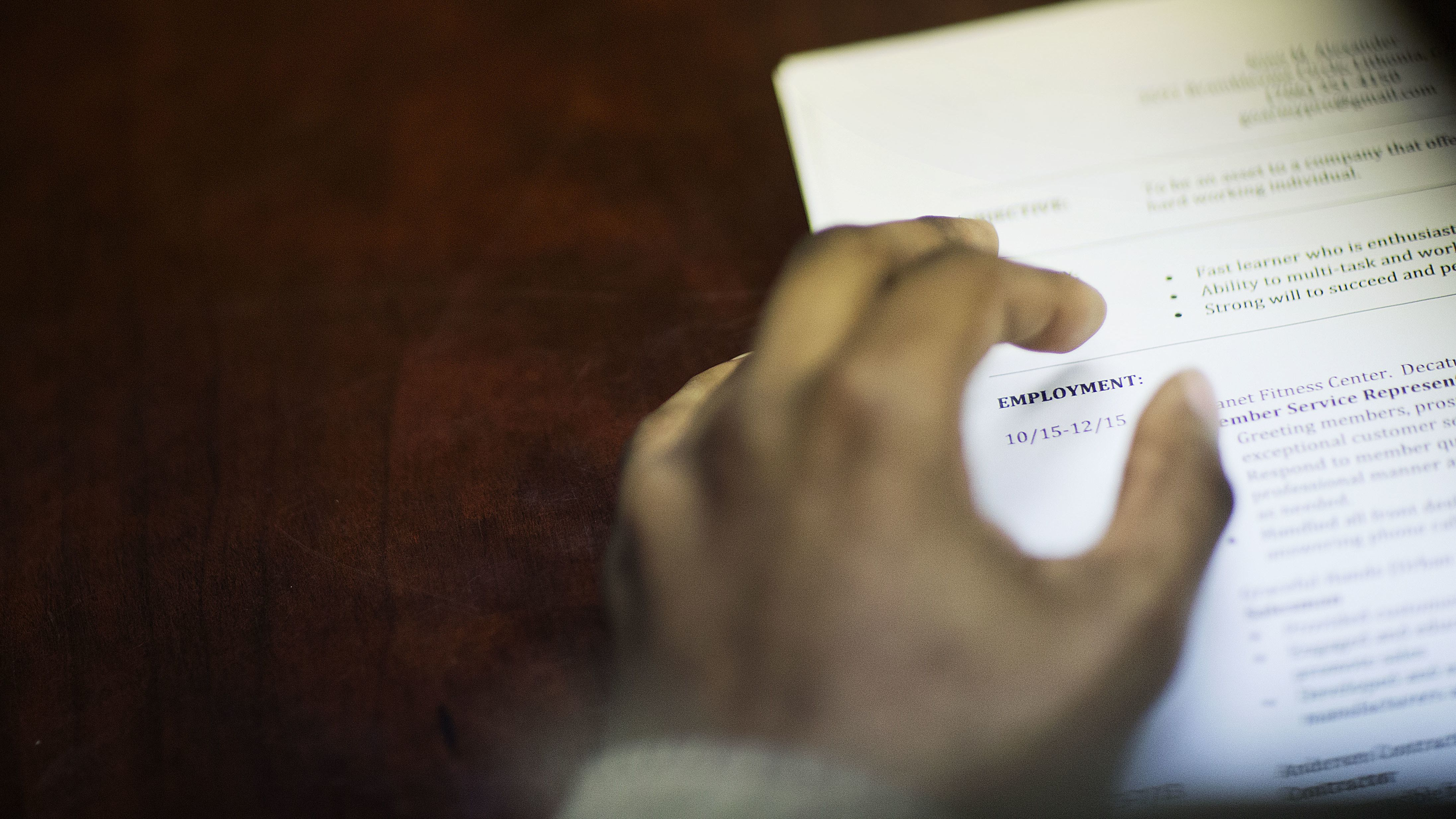 In this Thursday, March 3, 2016, file photo, a job candidate's resume sits on a table as he interviews for a job during a recruiting event at the Georgia Department of Labor office in Atlanta. Doubts deepened about the economy's health on Friday, June 3, 2016, when the government reported that hiring slowed to a near-standstill in May. While unemployment slid from 5 percent to 4.7 percent, the lowest since November 2007, the rate fell for a troubling reason: Nearly a half-million jobless Americans stopped looking for work and so were no longer counted as unemployed. (AP Photo/David Goldman, File)
