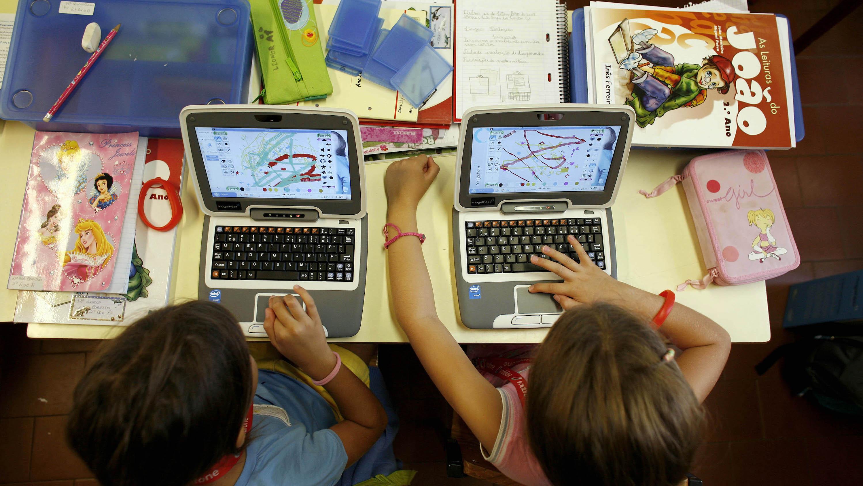Schoolgirls work on their new laptops at primary school in Lisbon