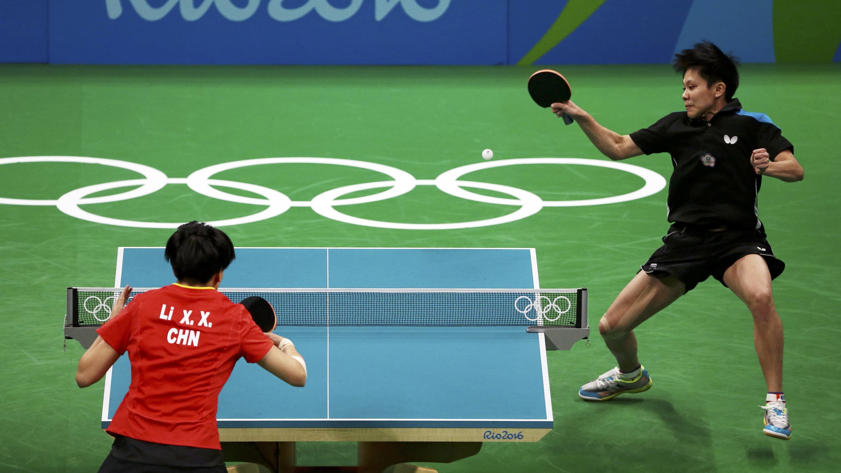 2016 Rio Olympics - Table Tennis - Quarterfinals - Women's Singles - Riocentro - Pavilion 3 - Rio de Janeiro, Brazil - 09/08/2016. Cheng I-Ching (TPE) of Taiwan plays against Li Xiaoxia (CHN) of China