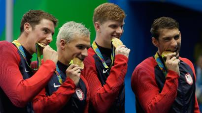 The United States team from left, Conor Dwyer, Ryan Lochte, Townley Haas and Michael Phelps celebrate with their gold medals after the men's 4x200-meter freestyle relay during the swimming competitions at the 2016 Summer Olympics, Wednesday, Aug. 10, 2016, in Rio de Janeiro, Brazil.