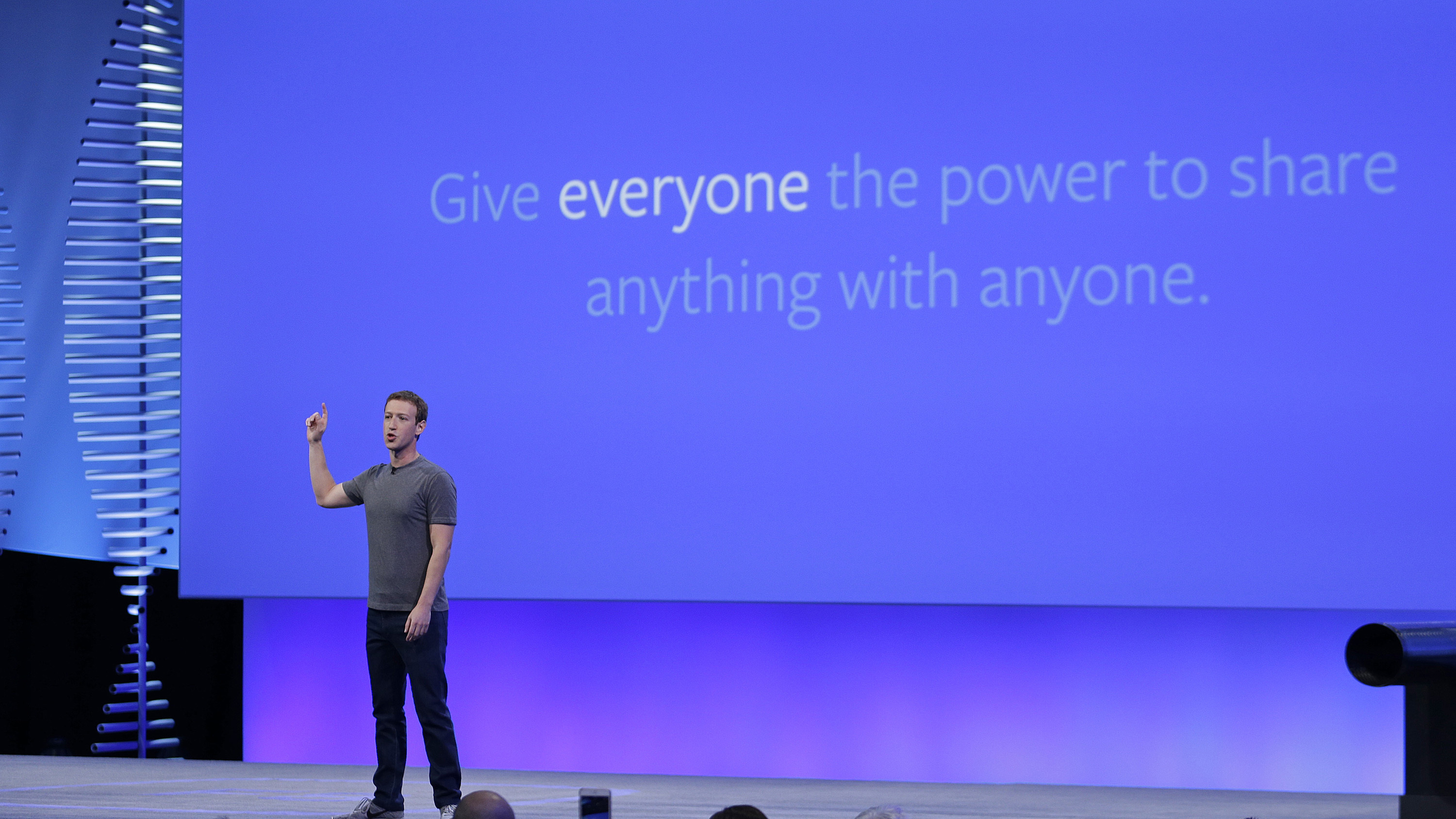 "Facebook CEO Mark Zuckerberg delivers the keynote address at the F8 Facebook Developer Conference Tuesday, April 12, 2016, in San Francisco. Zuckerberg said Facebook is releasing new tools that businesses can use to build ""chatbots,"" or programs that can talk to customers in conversational language. (AP Photo/Eric Risberg)"