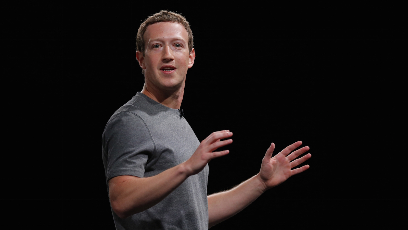 File-This Feb. 21, 2016, file photo sshows Facebook CEO Mark Zuckerberg speaking during the Samsung Galaxy Unpacked 2016 event in Barcelona, Spain. Some of Zuckerberg's neighbors are grumbling about a rock wall he's having built on his property on Kauai's north shore. Retiree Moku Crain said Tuesday, June 28, 2016, the wall looks daunting and forbidding. Crain hopes and expects Zuckerberg will soften the wall's look by planting foliage around it. The wall began going up about four to six weeks ago. It runs along the property next to a road in the semi-rural community of Kilauea. (AP Photo/Manu Fernadez, File)