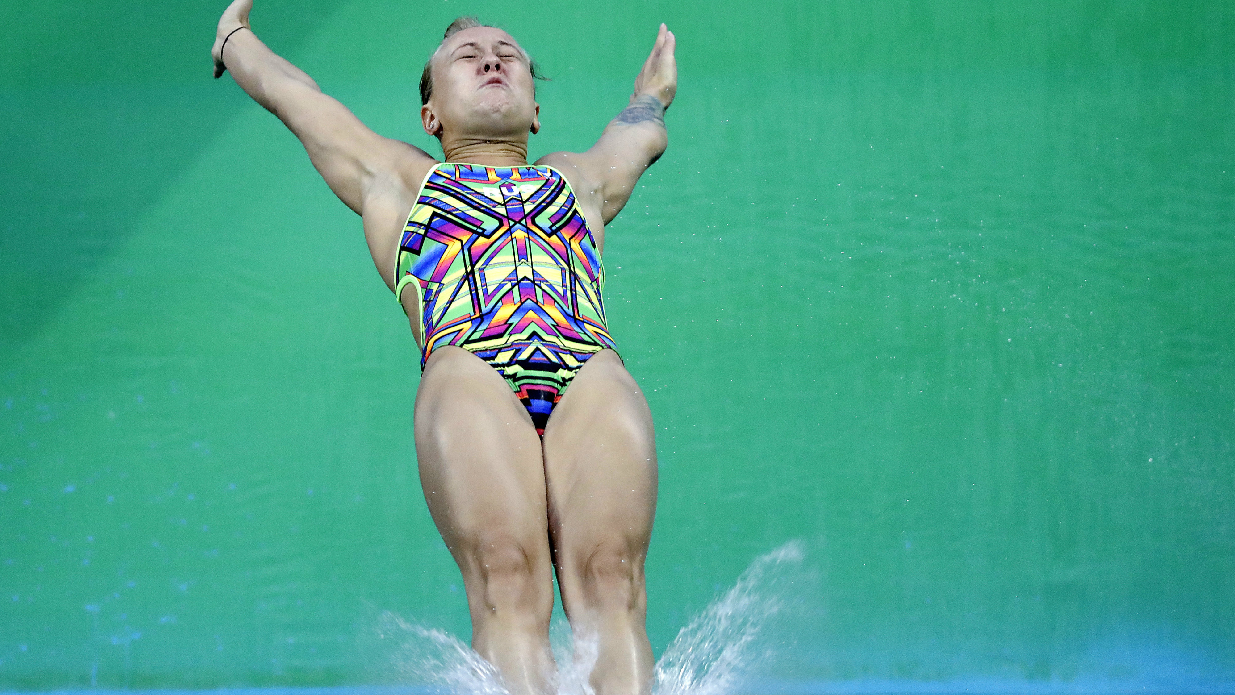 Russia's Nadezhda Bazhina back flops in to the water during the women's 3-meter springboard diving preliminary round.
