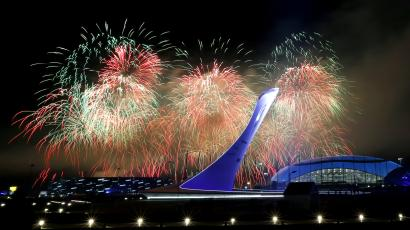 Fireworks burst over the Olympic cauldron during the closing ceremony of the 2014 Winter Olympics, Sunday, Feb. 23, 2014, in Sochi, Russia. (AP Photo/Julio Cortez)