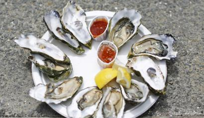 Raw oysters cracked open on a platter