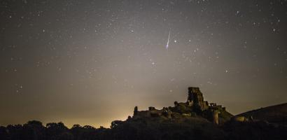 A Perseid meteor flashes across the night sky on Aug. 12, Corfe Castle, UK. The Perseids meteor shower occurs every year when the Earth passes through the cloud of debris left by Comet Swift-Tuttle, and appear to radiate from the constellation Perseus in the north eastern sky. (Photo by Dan Kitwood/Getty Images)