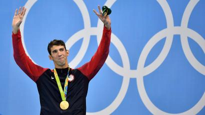 United States' Michael Phelps celebrates after he was awarded the gold medal during the medal ceremony for the men's 200-meter individual medley final during the swimming competitions at the 2016 Summer Olympics, Thursday, Aug. 11, 2016, in Rio de Janeiro, Brazil.