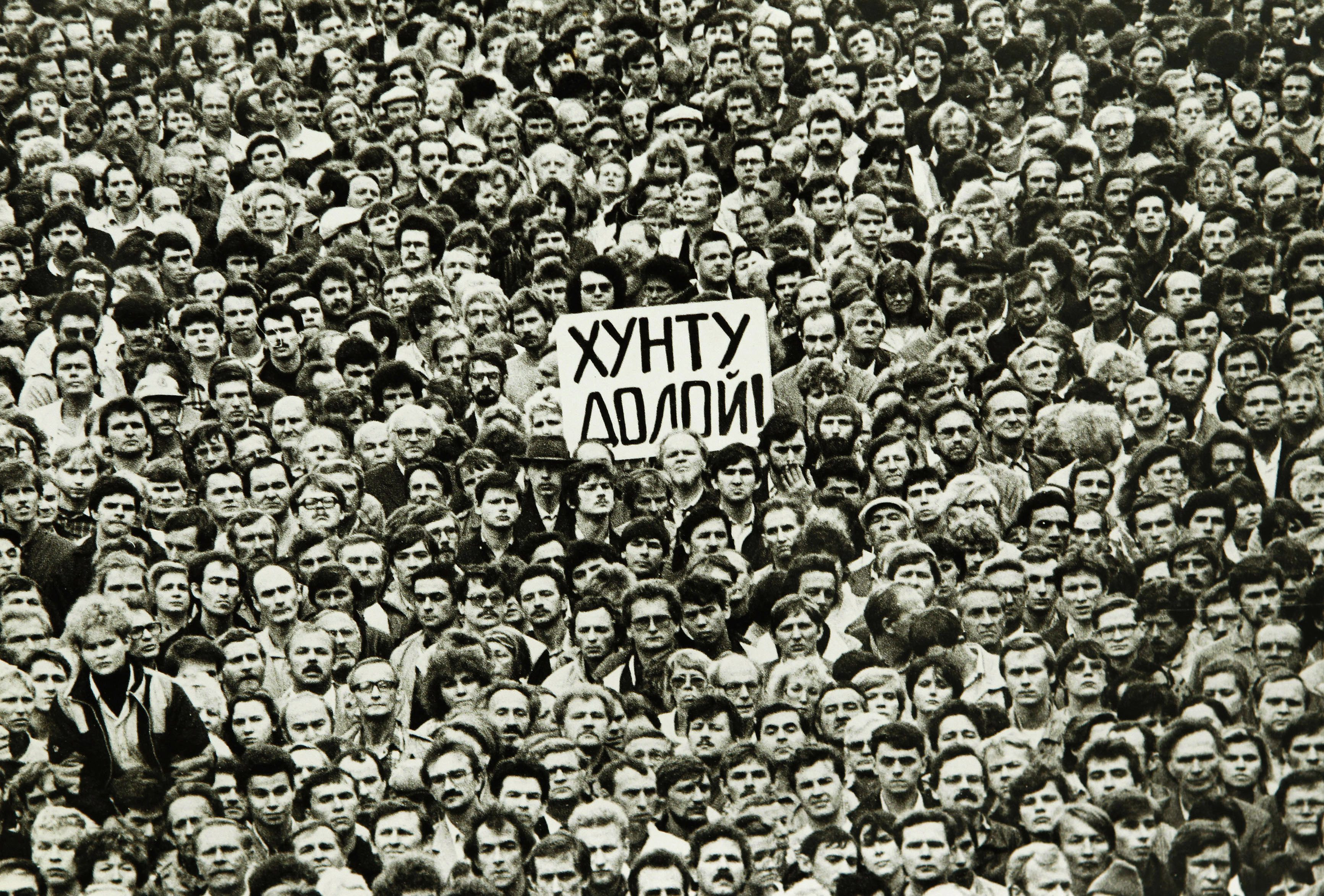 "People rally in support of Soviet President Mikhail Gorbachev and against the State Committee on the State of Emergency in Leningrad in this August 20, 1991 file photo. Twenty years after a failed coup hastened the end of the Soviet Union, many Russians look back with regret and cynicism, underscoring the ambivalence many feel for the new Russia and their uncertainty about the future. The placard reads, ""Down with the junta""."