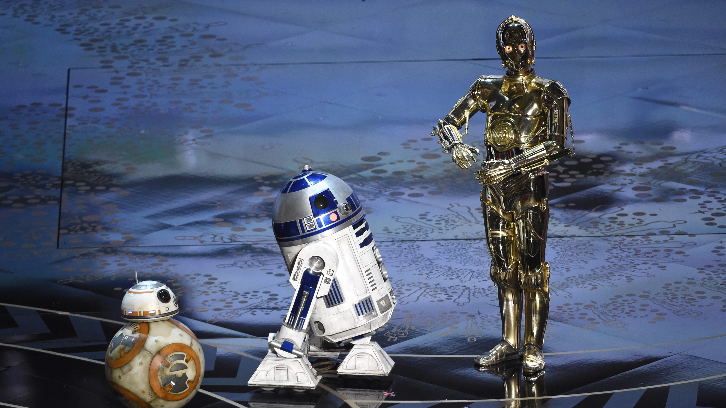 BB-8, from left, R2-D2, and C-3PO speak at the Oscars on Sunday, Feb. 28, 2016, at the Dolby Theatre in Los Angeles. (Photo by Chris Pizzello/Invision/AP)