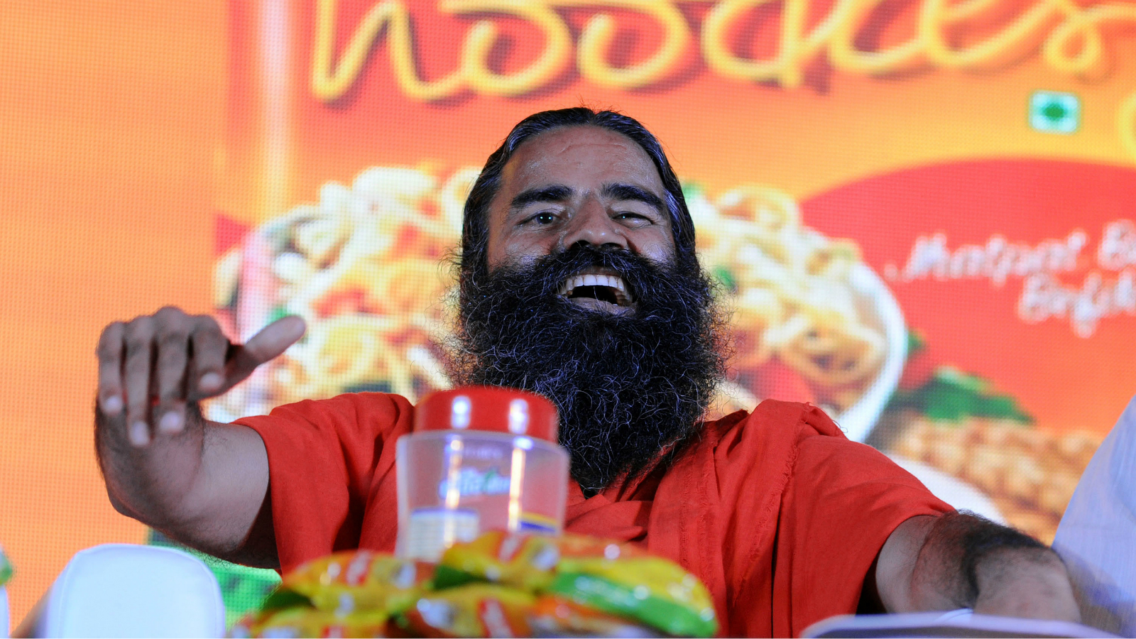 Yoga guru Baba Ramdev speaks at a press conference after launching Patanjali Atta Noodle in New Delhi, India, 16 November 2015. The new product would cost 0.23 USD with no added lead or monosodium glutamate (MSG) and hit the market soon. Swiss food giant Nestle has also resumed the manufacture and sale of its Maggi brand instant noodles in India after it withdrew the product in June after India's Food Safety and Standards Authority said Maggi noodles contained 'unsafe and hazardous' levels of lead, a news reports said.