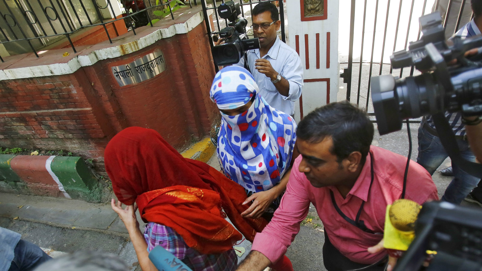Two women who had filed rape complaints being chased by Indian media personnel in New Delhi in September 2015.