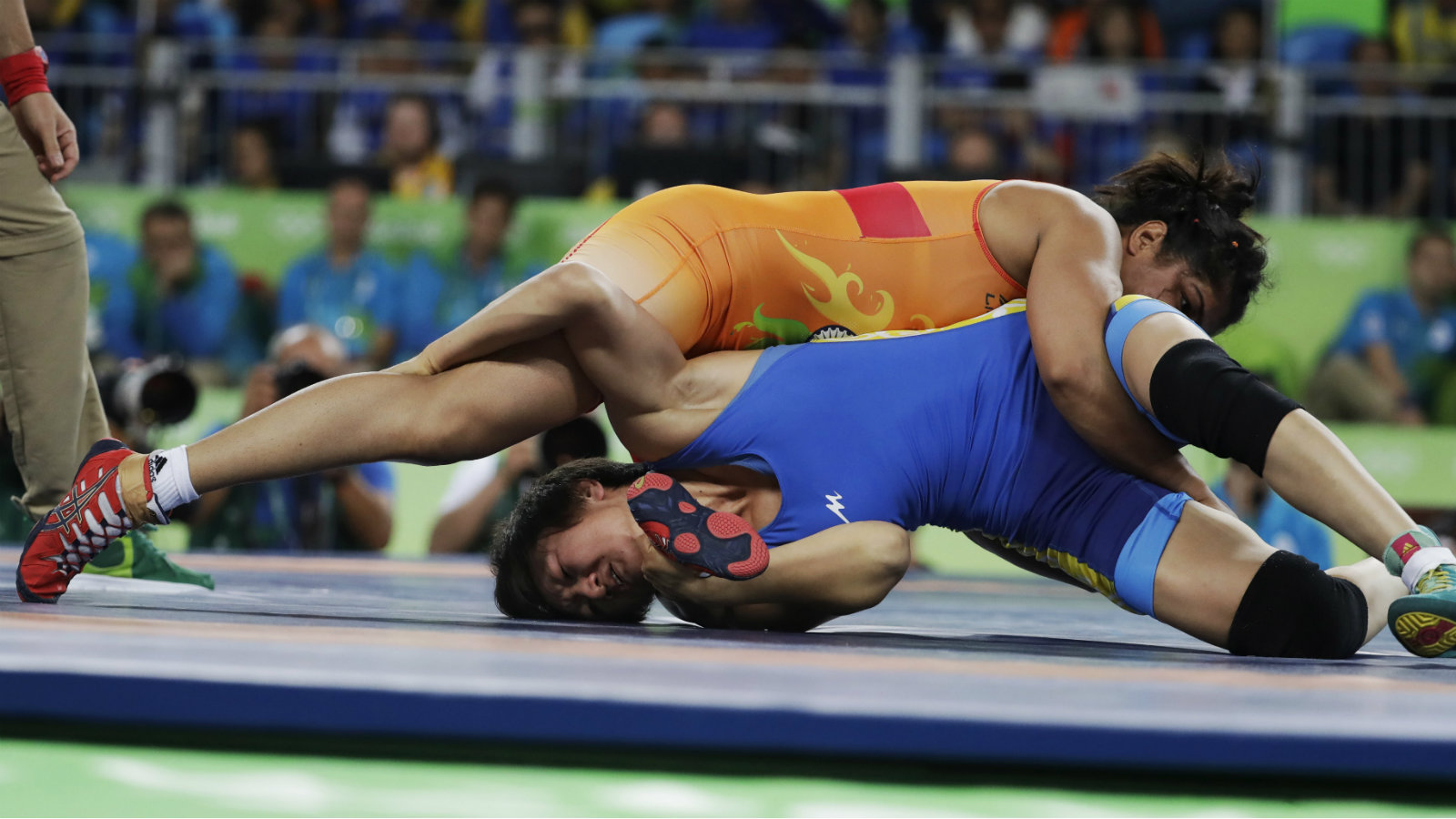 India's Sakshi Malik, top, competes against Kyrgyzstan's Aisuluu Tynybekova in the women's wrestling freestyle 58-kg competition at the 2016 Summer Olympics in Rio de Janeiro, Brazil, Wednesday, Aug. 17, 2016.