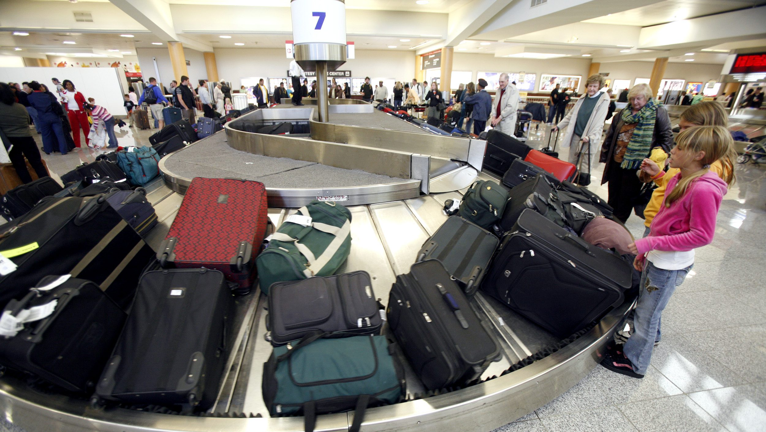 c070324dc Checked baggage fees have a hidden benefit for passengers—fewer flight  delays