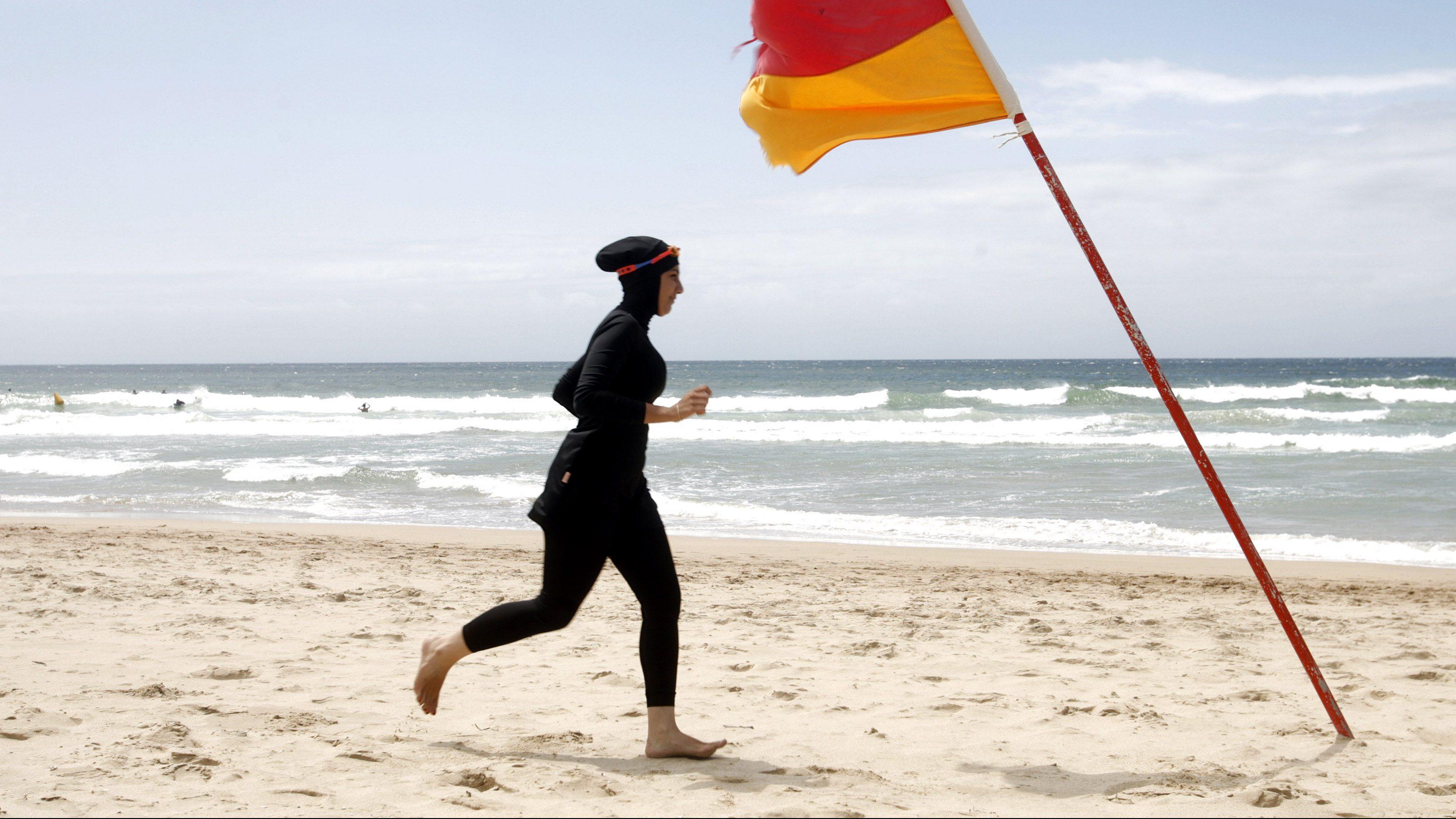 Trainee volunteer surf life saver Laalaa runs along North Cronulla Beach in Sydney