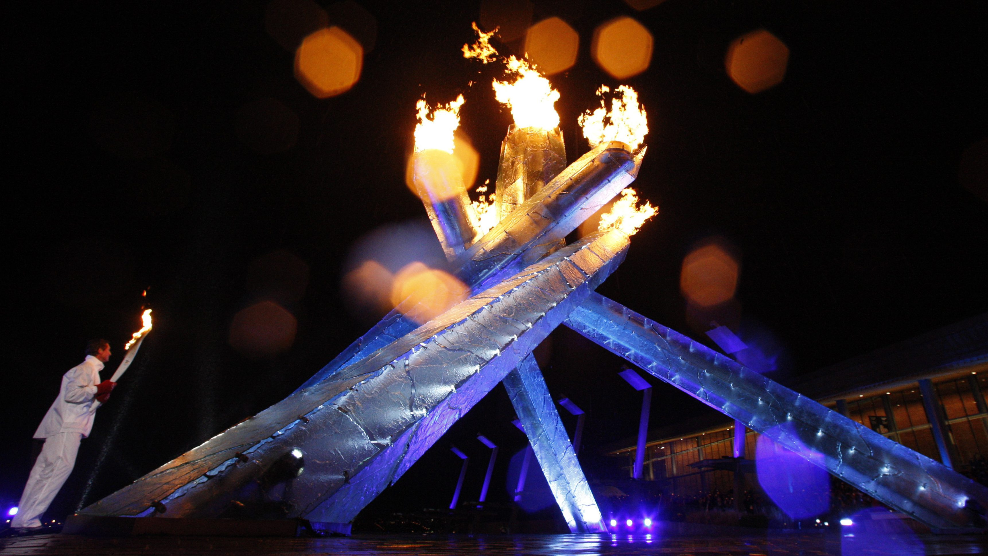 The Olympic flame burns in the permanent cauldron after it was lit by Canadian hockey legend Wayne Gretzky during the opening ceremony of the Vancouver 2010 Winter Olympics February 12, 2010. REUTERS/Hans Deryk (CANADA) - RTR2A6E5