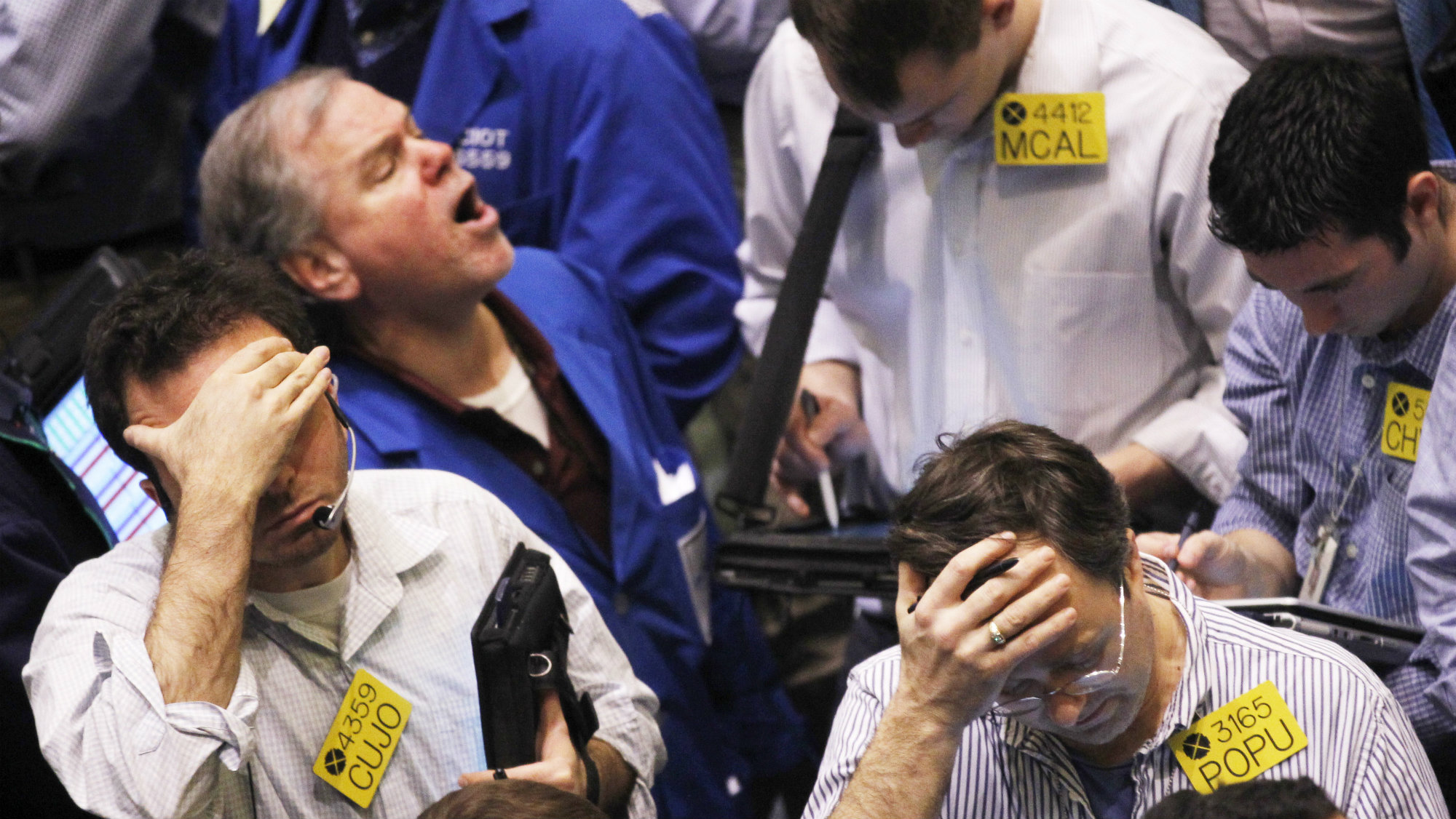 Traders work in the oil options pit on the floor of the New York Mercantile Exchange in New York City, February 22, 201