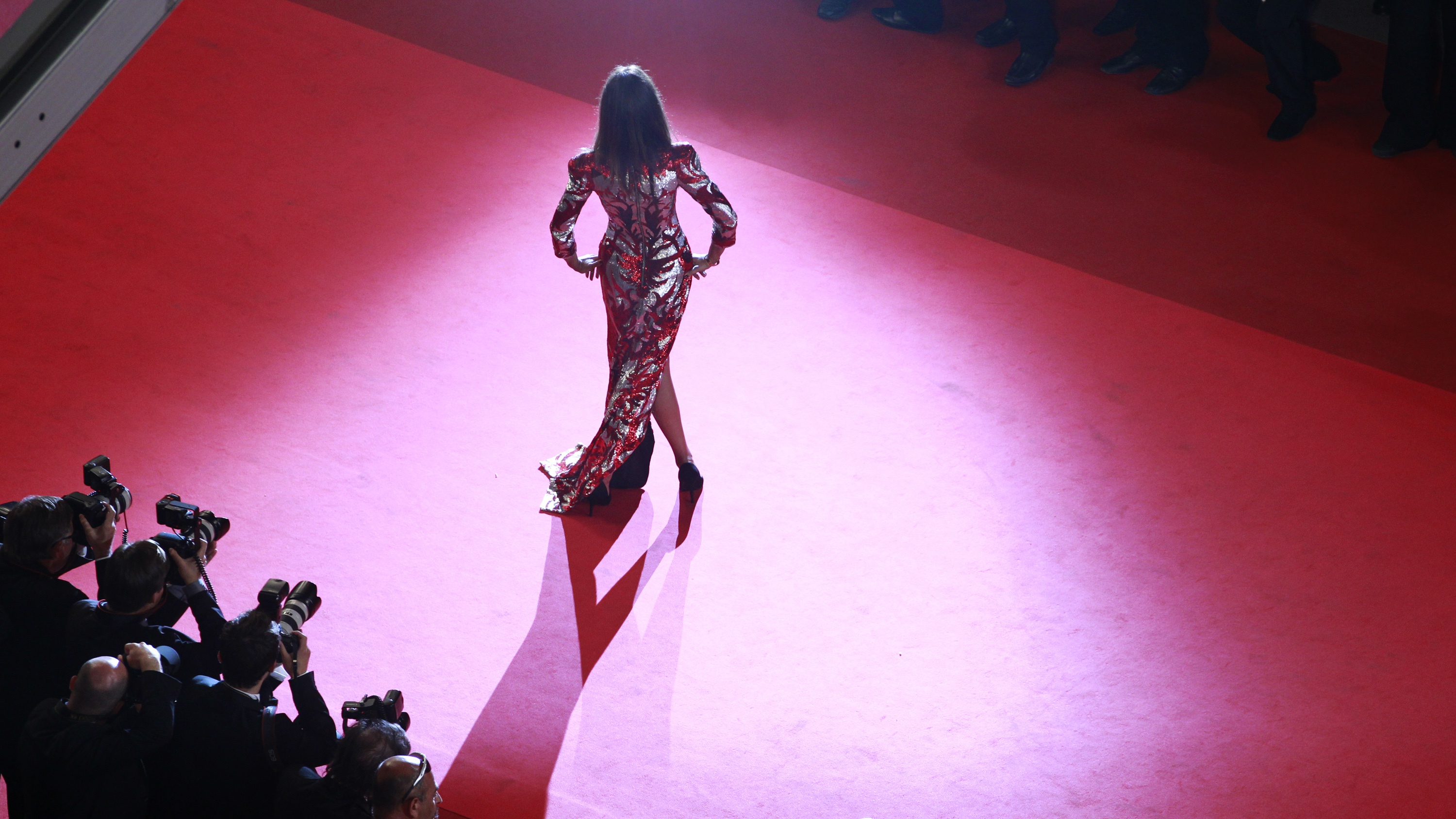 """An unidentified guest arrives on the red carpet for the screening of the film """"Drive"""", in competition at the 64th Cannes Film Festival, May 20, 2011. REUTERS/Eric Gaillard"""