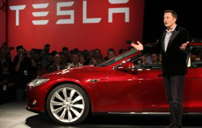 Tesla Motors CEO Elon Musk speaks next to the company's newest Model S during the Model S Beta Event held at the Tesla factory in Fremont, California October 1, 2011. The Model S is the company's first full-size electric sedan set for release in 2012. REUTERS/Stephen Lam (UNITED STATES - Tags: TRANSPORT BUSINESS LOGO SCIENCE TECHNOLOGY) - RTR2S40H