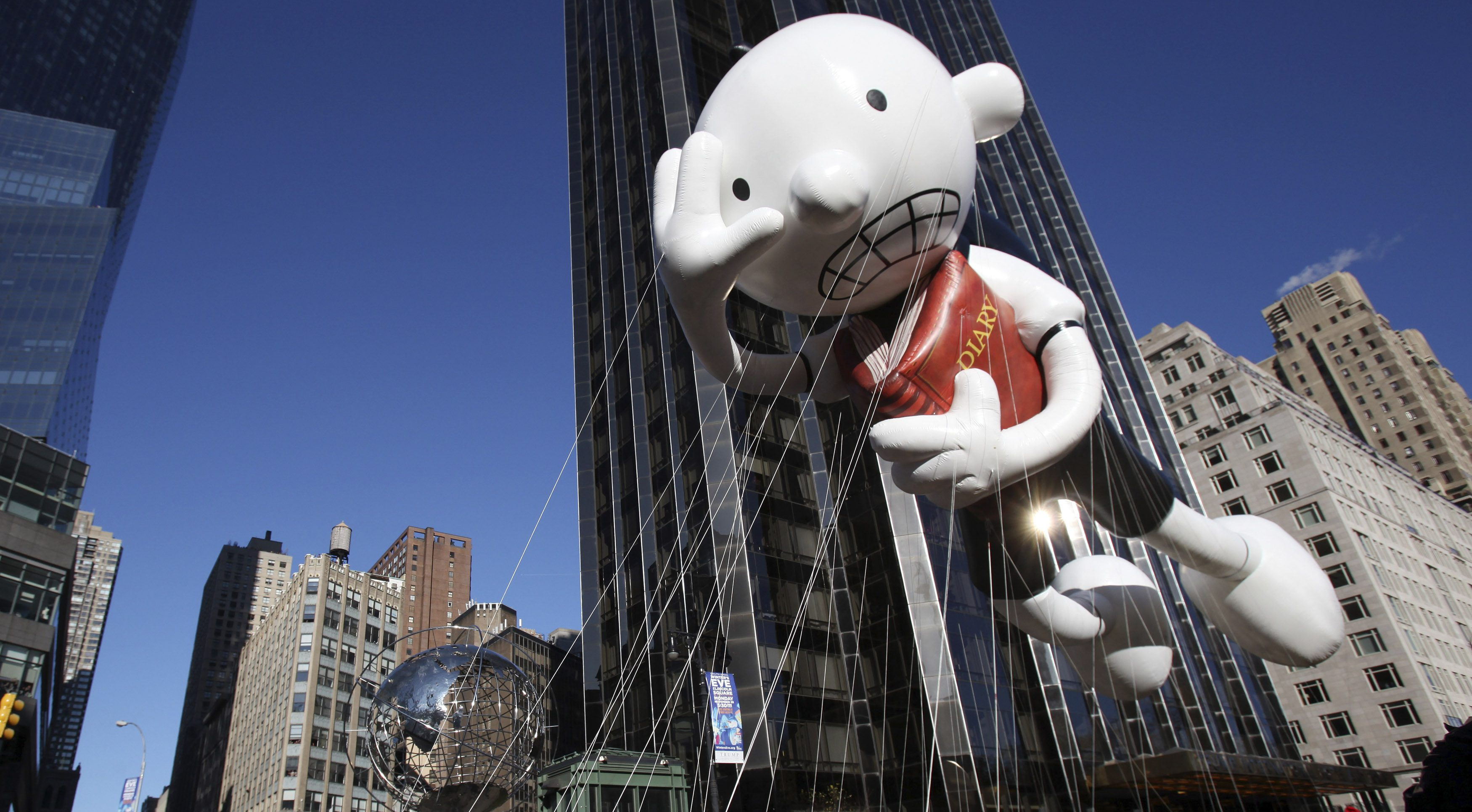 The Diary of a Wimpy Kid balloon floats around Columbus Circle during the 85th annual Macy's Thanksgiving day parade in New York November 24, 2011. REUTERS/Shannon Stapleton (UNITED STATES - Tags: ENTERTAINMENT SOCIETY) - RTR2UF6E