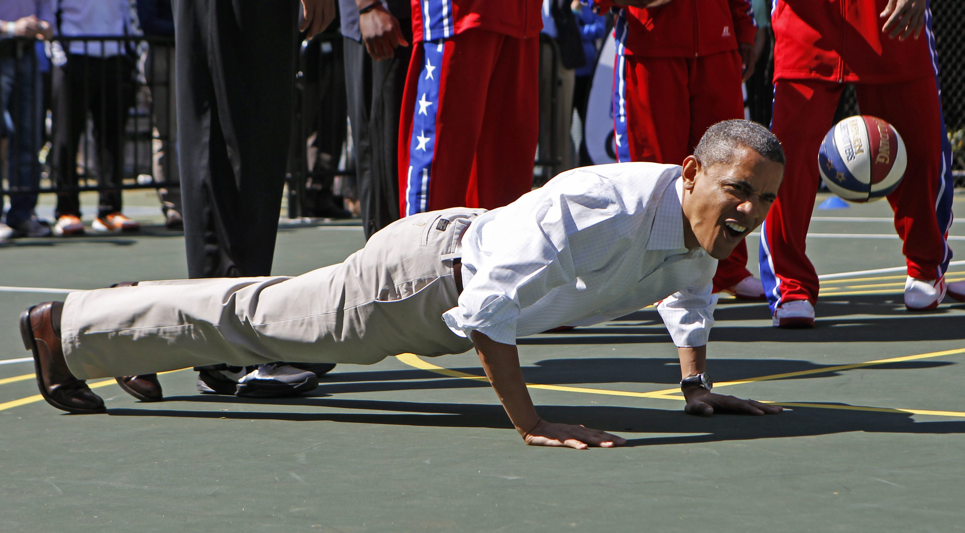 President Obama does push-ups at the Easter Egg Roll in Washington