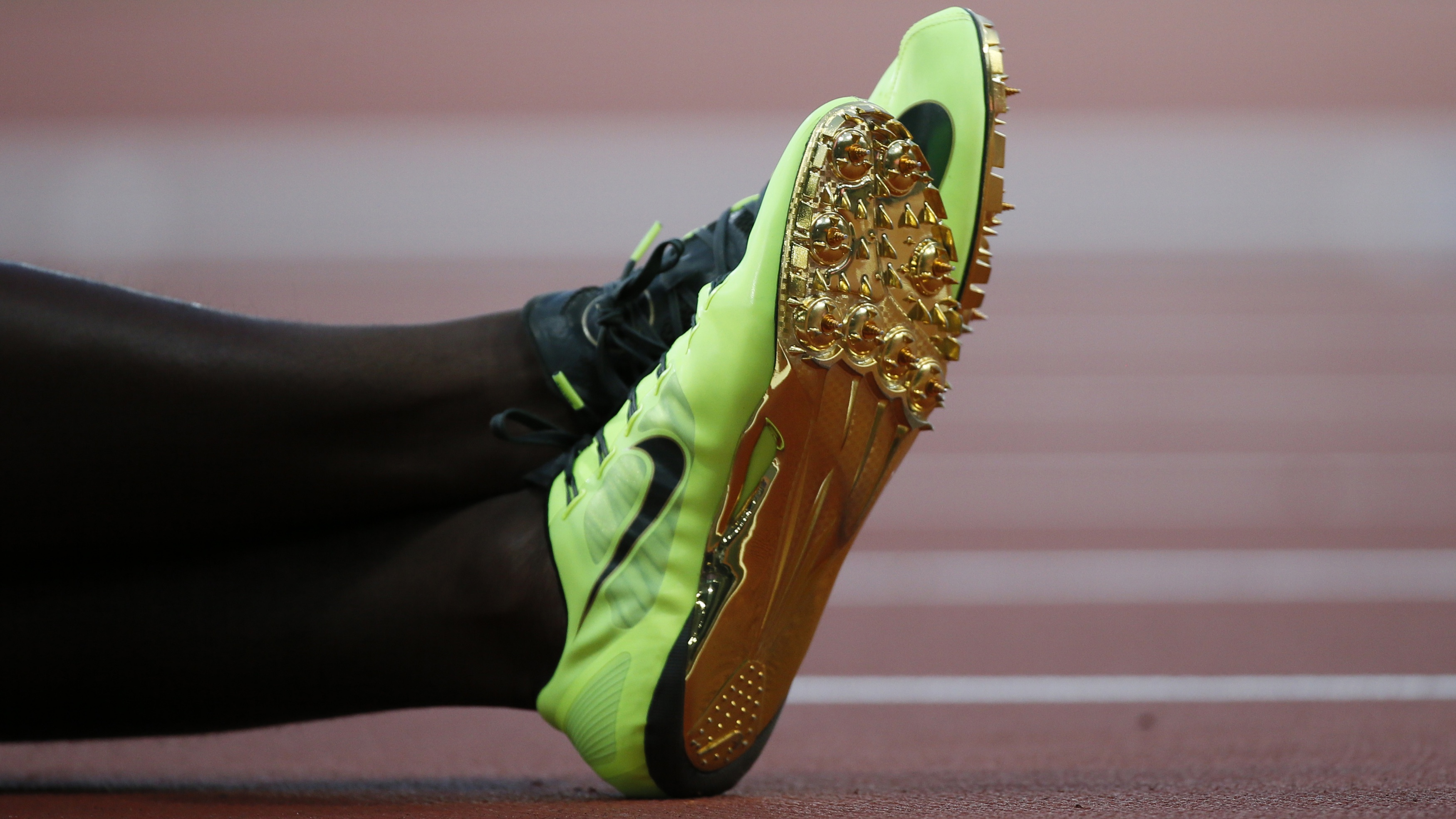 The shoes of Canada's Justyn Warner are seen during the men's 100m semi-final during the London 2012 Olympic Games at the Olympic Stadium August 5, 2012. REUTERS/Lucy Nicholson (BRITAIN - Tags: SPORT ATHLETICS OLYMPICS)