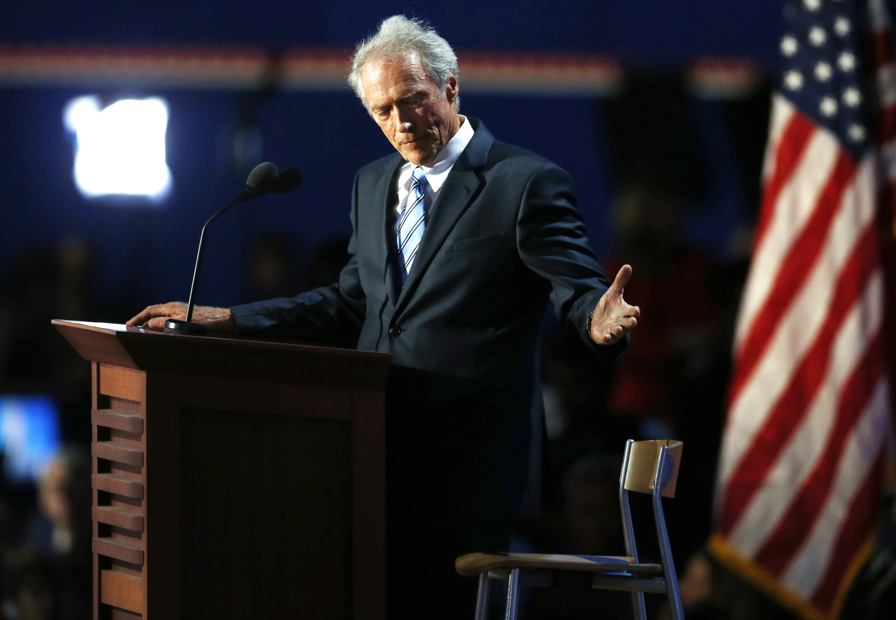 Actor Clint Eastwood addresses an empty chair while speaking during the final session of the Republican National Convention in Tampa