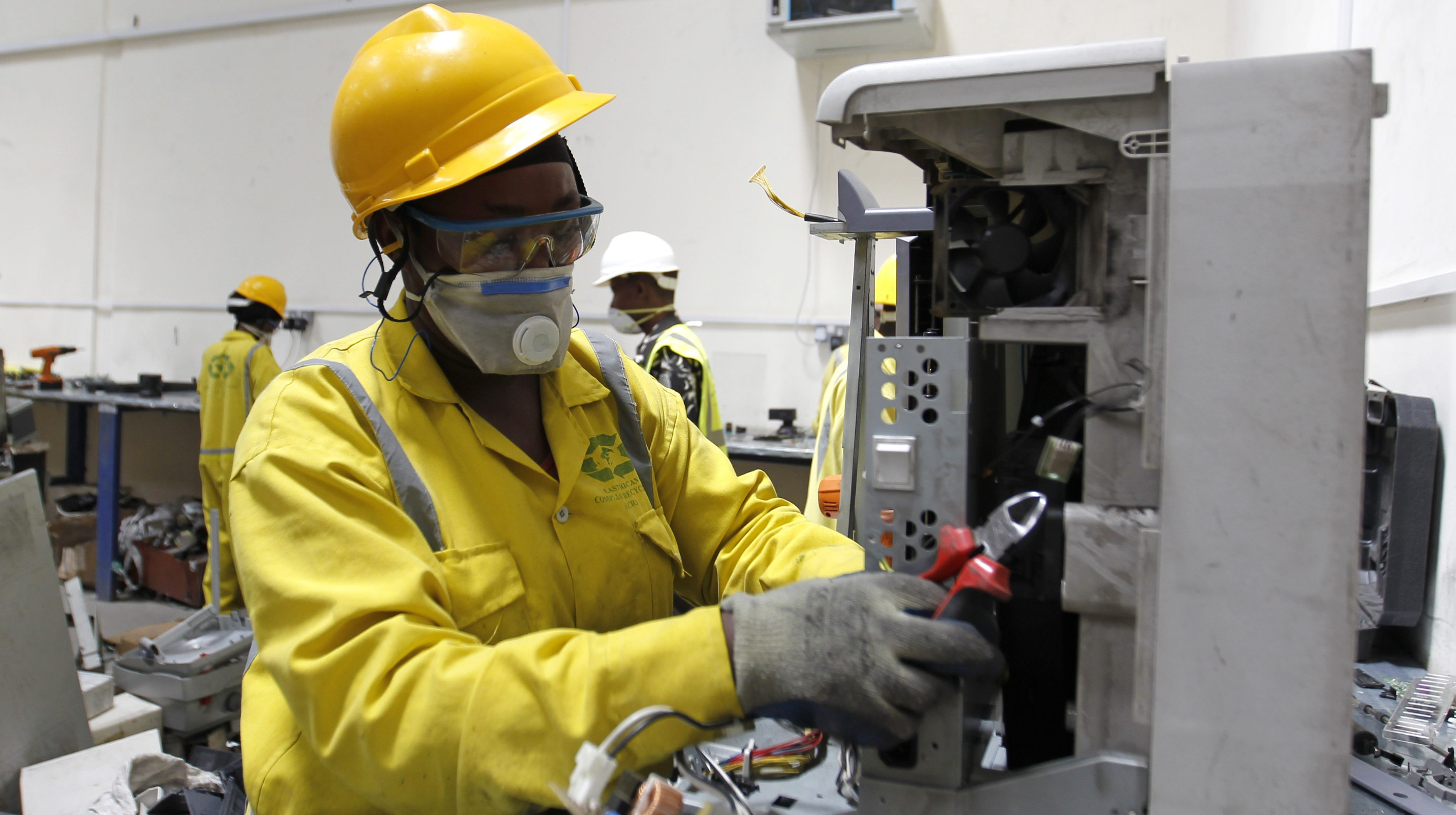 An employee dismantles parts of discarded computers and other electronics for recycling at the EACR facility in Athi River near Kenya's capital Nairobi
