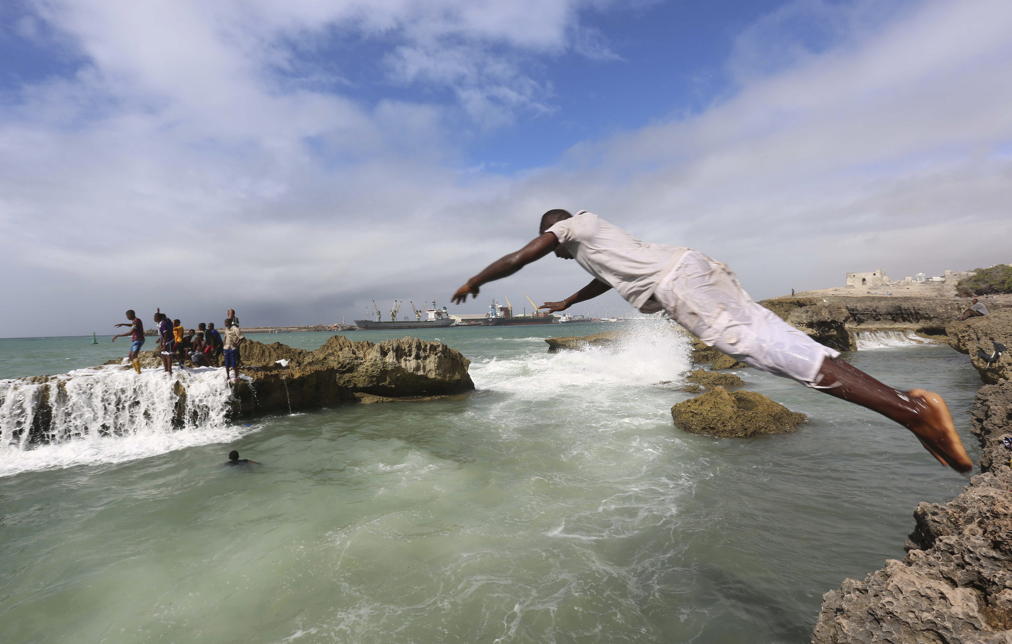 A man dives into the Indian Ocean waters at Lido beach, north of Somalia's capital Mogadishu