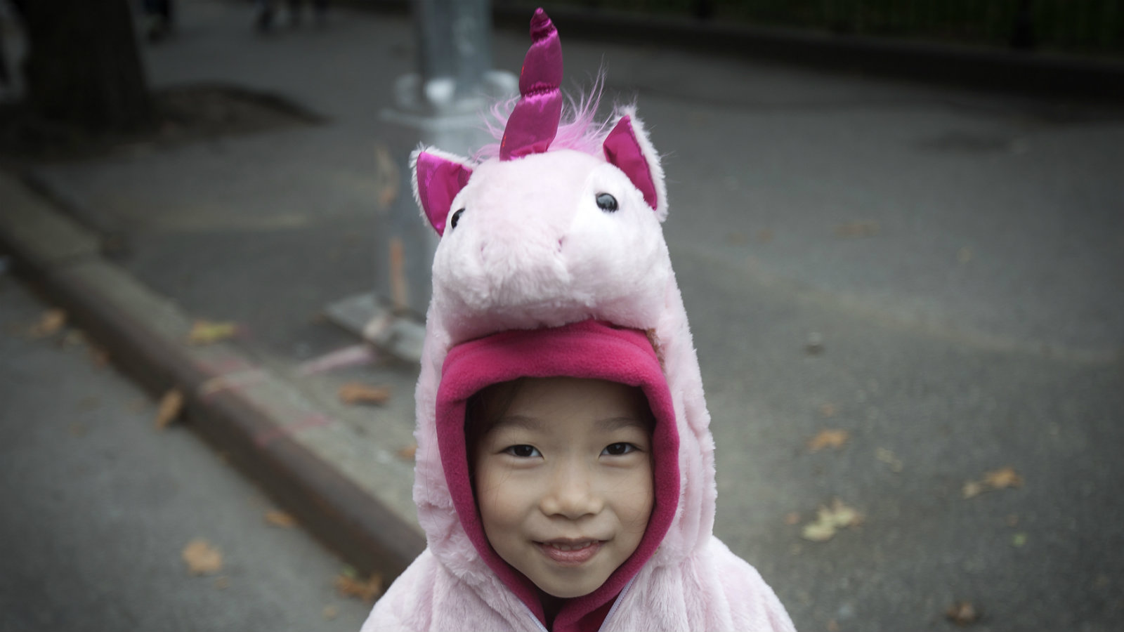 A child in a unicorn costume takes part in the 24th Annual Greenwich Village Children's Halloween Parade in the Manhattan borough of New York October 31, 2014.