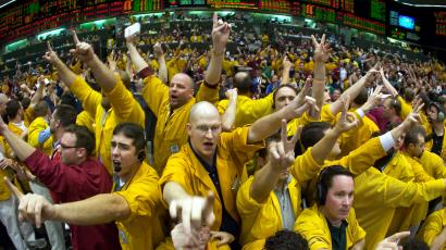 Traders react in a trading pit at the Chicago Mercantile Exchange