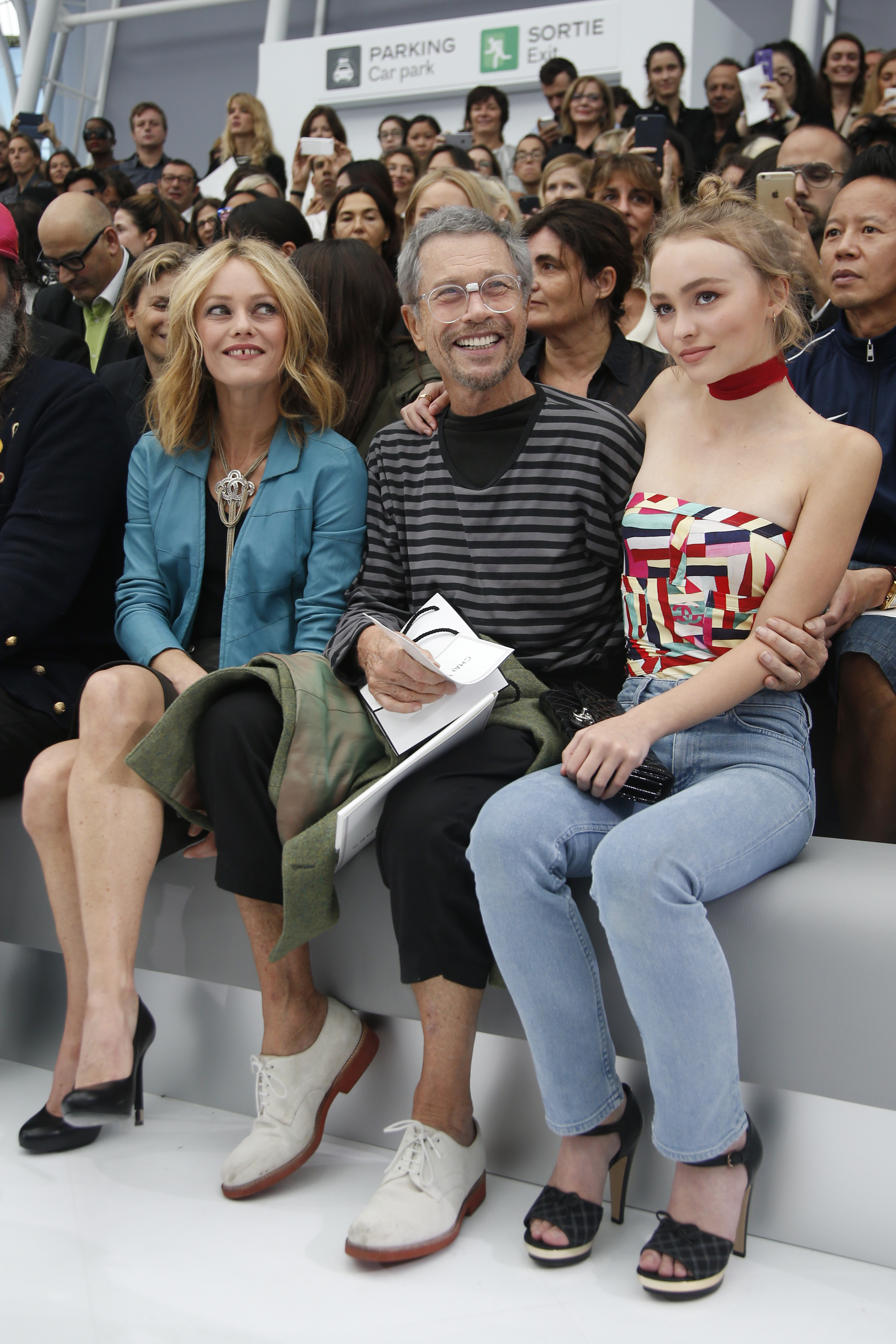 French singer Vanessa Paradis (L), her daughter Lily-Rose Depp (R) and French artist Jean-Paul Goude (C) attend the Spring/Summer 2016 women's ready-to-wear collection for fashion house Chanel at the Grand Palais which is transformed into a Chanel airport during the Fashion Week in Paris, France, October 6, 2015. REUTERS/Charles Platiau - RTS38C5