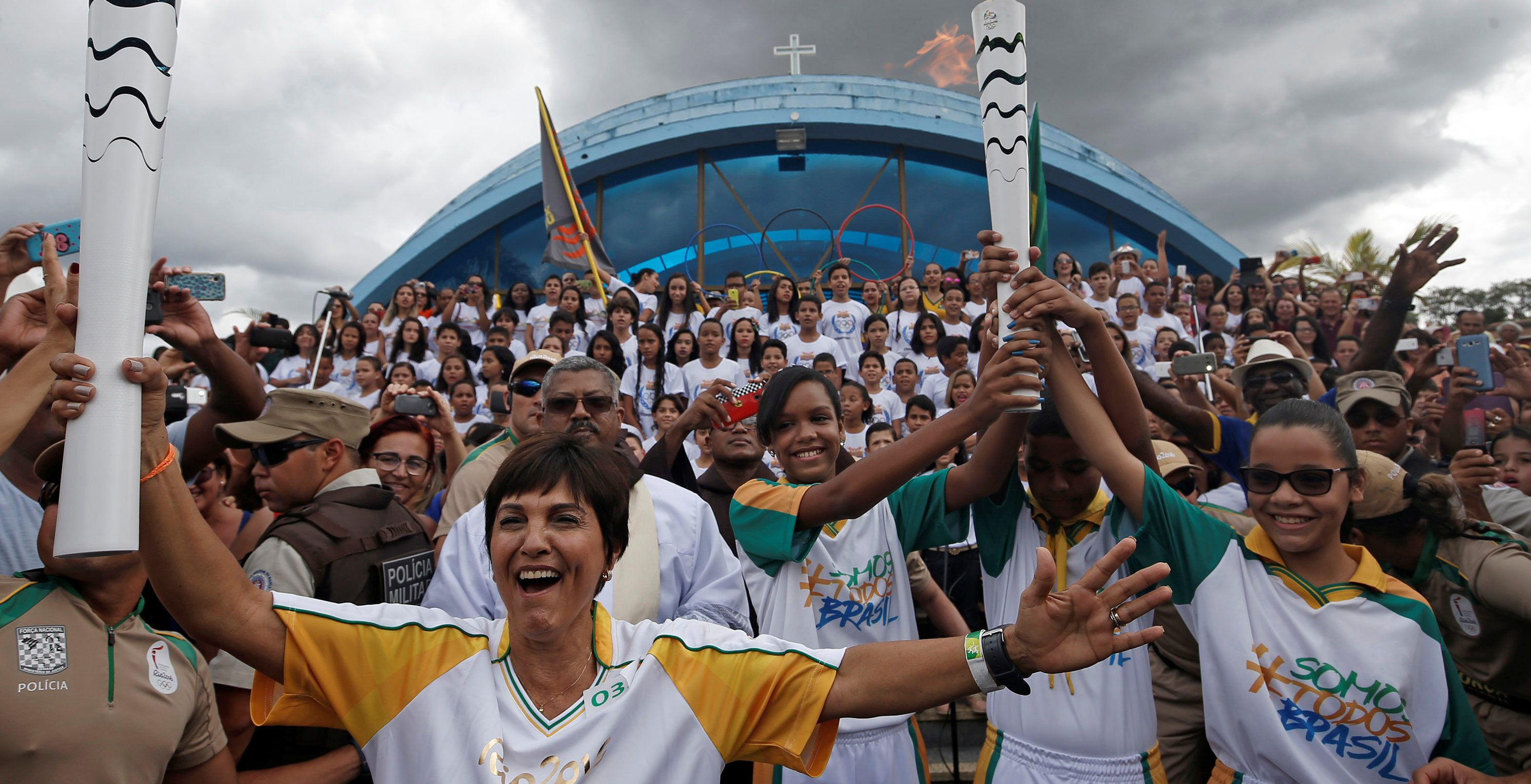 Resident Maria da Gloria takes part in the Olympic Flame torch relay in Itamaraju, Bahia state, Brazil