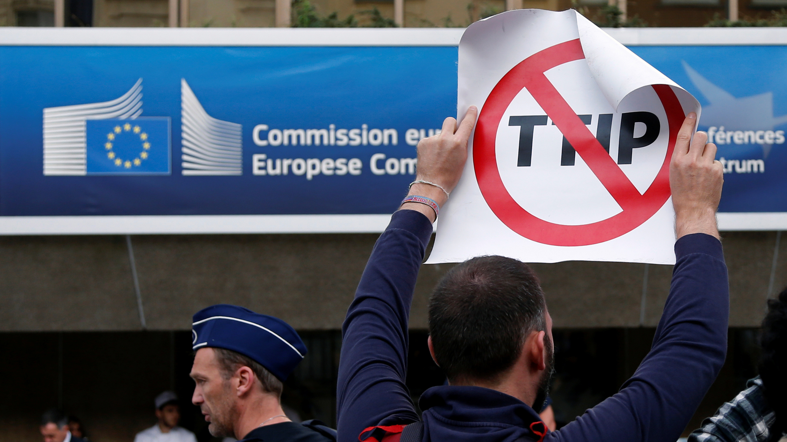 A protestors holds a sign protesting TTIP.