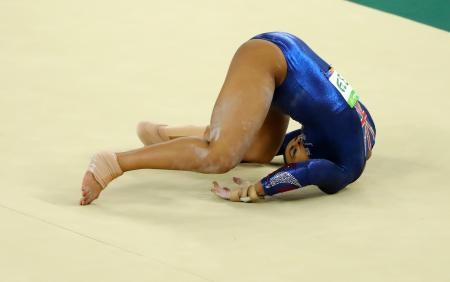 Elissa Downie of Britain falls and injures herself during the women's artistic gymnastics qualifications at the Rio 2016 Olympics.
