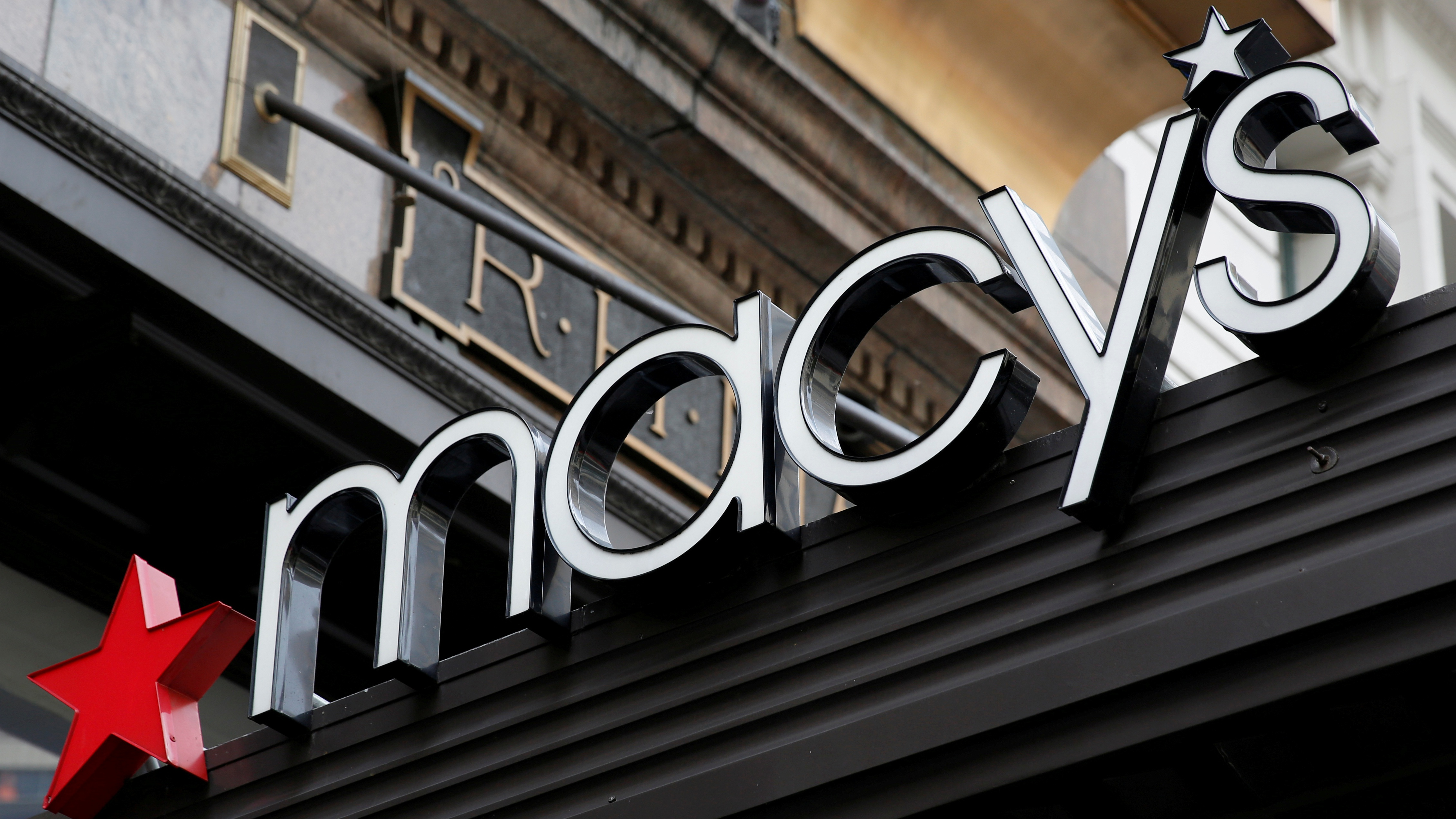 """A sign that marks the Macy's store is seen at the Herald Square location in New York, U.S., May 9, 2016. REUTERS/Shannon Stapleton/File Photo GLOBAL BUSINESS WEEK AHEAD PACKAGE - SEARCH """"BUSINESS WEEK AHEAD AUG 8"""" FOR ALL IMAGES?"""