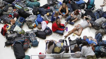 Members of the mission group Adventures In Missions wait to find out if their flight to Guatemala is on time or cancelled after Delta Air Lines' computer systems crashed on Monday, grounding flights around the globe, at Hartsfield Jackson Atlanta International Airport in Atlanta, Georgia, U.S. August 8, 2016.