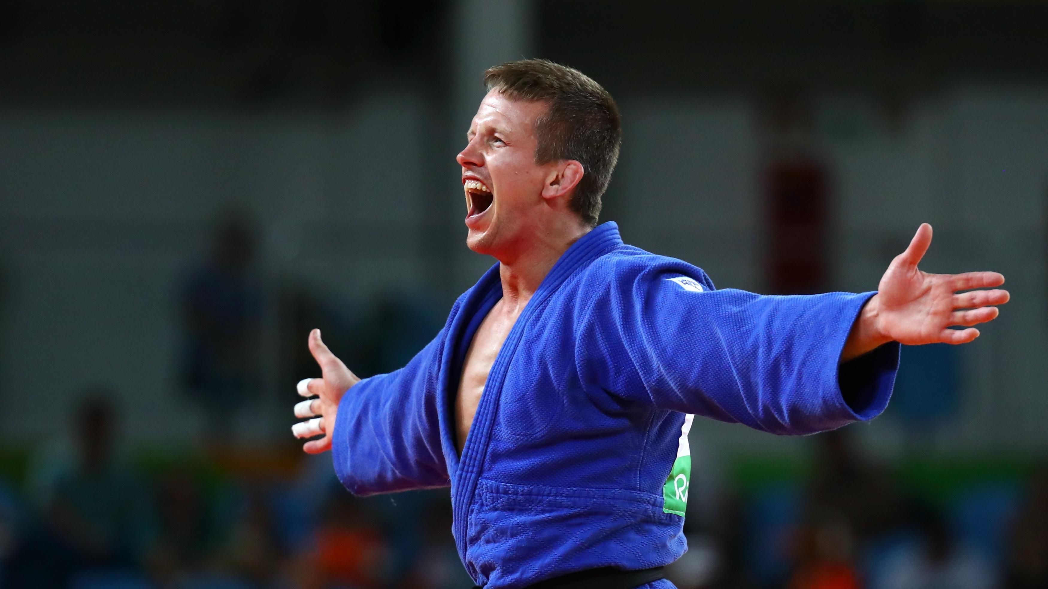 2016 Rio Olympics - Judo - Final - Men -73 kg Bronze Medal Contests - Carioca Arena 2 - Rio de Janeiro, Brazil - 08/08/2016. Dirk Van Tichelt (BEL) of Belgium celebrates. REUTERS/Kai Pfaffenbach FOR EDITORIAL USE ONLY. NOT FOR SALE FOR MARKETING OR ADVERTISING CAMPAIGNS.