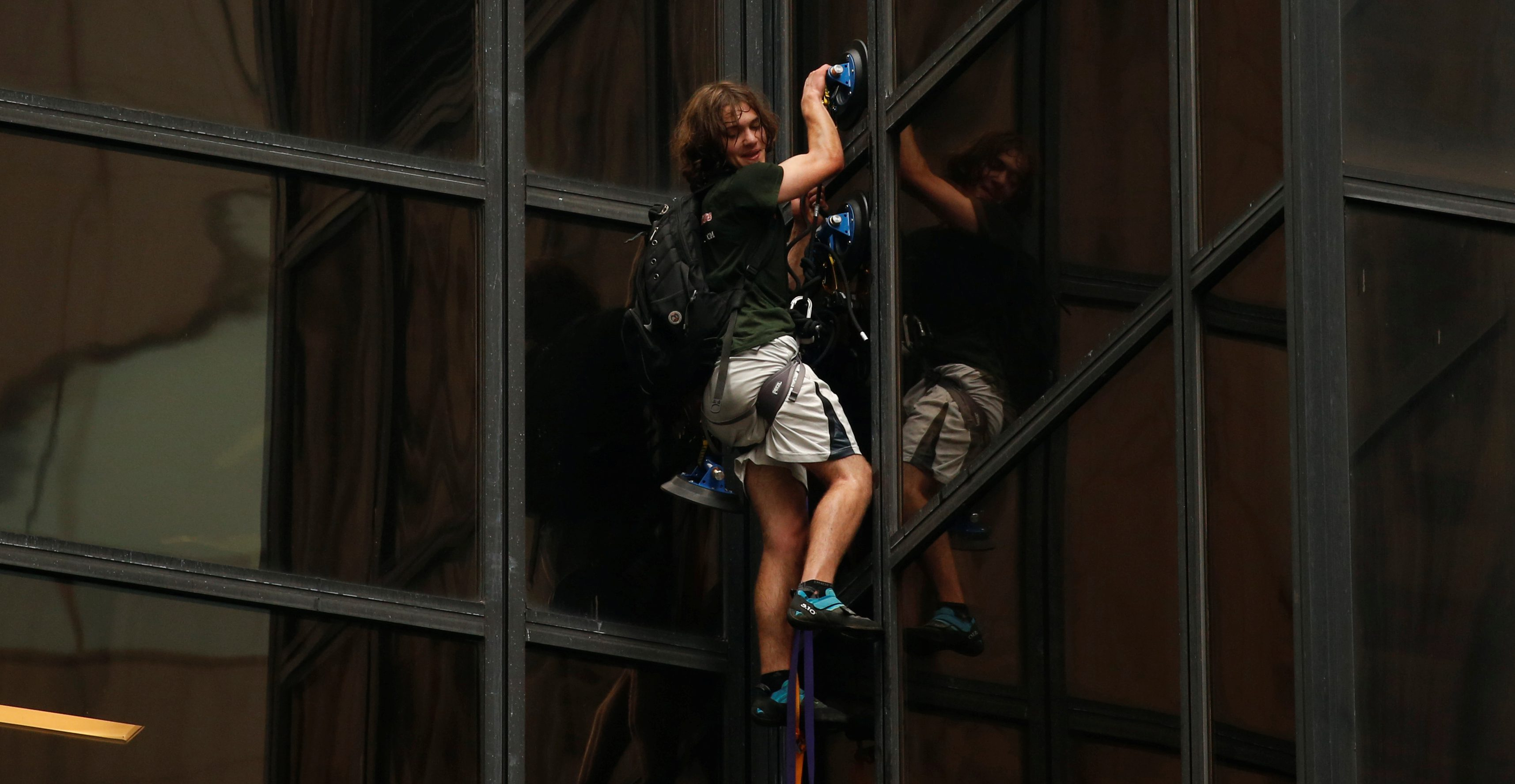 A man climbs the outside of Trump Tower in New York on Aug. 10.